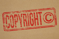 Copyright. Rubber stamp impression on brown paper background Royalty Free Stock Image