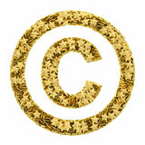 Copyright sign composed of golden Stock Photography