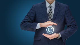 Copyright symbol from a businessman . Royalty Free Stock Images
