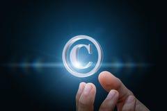 Copyright symbol in businessman hand. Copyright symbol in business man hand Royalty Free Stock Photography