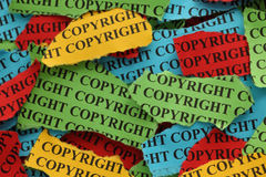 Copyright. Torn pieces of colored paper with the word Copyright. Copyright concept. Close-up Stock Photography