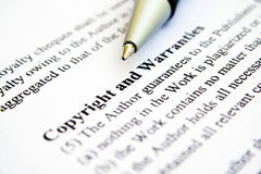 Copyright and warranties Stock Images
