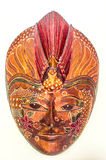 Copyrighted free image or picture of batik painted wooden mask in reddish brown. Copyrighted free image of batik painted wooden mask in reddish brown Royalty Free Stock Images
