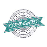 Copyrighted stamp. Copyrighted grunge rubber stamp on white Royalty Free Stock Image