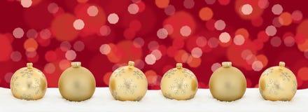 Copys dourados do fundo da decoração da bandeira das bolas das luzes de Natal Fotos de Stock Royalty Free