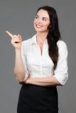 женщина copyspace дела указывая Стоковое фото RF