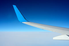 Copyspace airplane wing in the sky Royalty Free Stock Photography