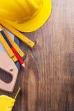 Copyspace background set of tools handsaw tapeline Stock Photo