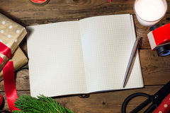 Copyspace with christmas book  on wood table. Stock Photos
