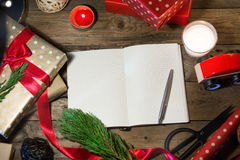 Copyspace with christmas book  on wood table. Royalty Free Stock Photography