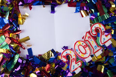 Copyspace with confetti and year 2012 candles Royalty Free Stock Photo