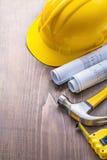 Copyspace image blueprints hammer tapeline helmet Stock Image
