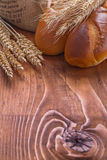 Copyspace image bread and wheat ears on old wooden Royalty Free Stock Images