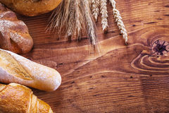 Copyspace image bread and wheat ears on vintage Stock Photos