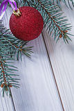 Copyspace image christmas ball on white boards and branch of pin Stock Image