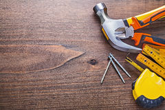 Copyspace image claw hammer nails tapeline wooden Stock Images