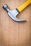 Copyspace image claw hammer on wooden board very close up Royalty Free Stock Photos