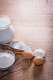 Copyspace image flour in spoon bowl and scoop eggs Stock Photography