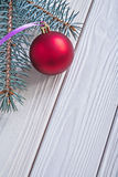 Copyspace image mat red christmas ball and pinetree branch on wh Stock Image