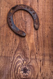 Copyspace image the old rusty horseshoe on vintage Stock Images