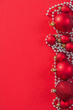 Copyspace image red christmas baubles on background Royalty Free Stock Images