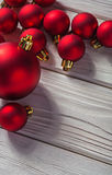 Copyspace image red christmas baubles on old painted white woode Royalty Free Stock Image