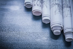 Copyspace image rolls of blueprints on blue board Royalty Free Stock Photo