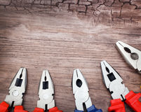 Copyspace image set of pliers on wooden board Royalty Free Stock Photos