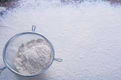 Copyspace image sieve with white natural flour Stock Image