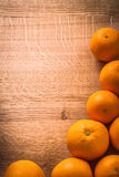 Copyspace image stack of fresh orange fruits on Royalty Free Stock Photography