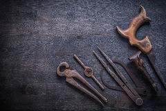 Copyspace image vinatge rusted tools on dark board Stock Images