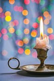 Copyspace image vintage candlestick with burning candle on backg Stock Photography