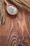 Copyspace image wooden spoon with ears of wheat on Stock Image