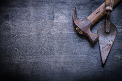 Copyspace vintage tools claw hammer putty knife on wood board Royalty Free Stock Photos