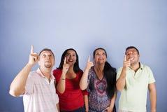 copyspacegruppfolk som pekar till upp Royaltyfri Foto