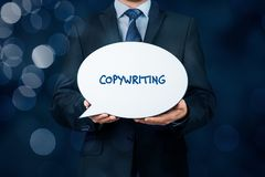 Copywriting concept. Copywriter hold bubble speech with text copywriting as propagation of his work stock images