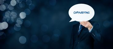 Copywriting concept. Copywriter hold bubble speech with text copywriting as propagation of his work stock photography