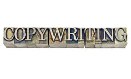 Copywriting ord i metalltyp arkivfoton