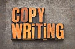 Copywriting ordabstrakt begrepp i wood typ för boktryck royaltyfri bild