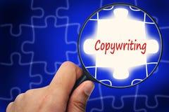 Copywriting uttrycker Förstoringsapparat och pussel Arkivfoto