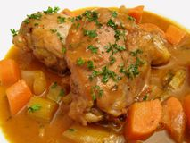 Coq Au Vin. Photo of French recipe called Coq Au Vin-chicken in red wine sauce.  This recipe is usually served with carrots, celery, onions and mushrooms Stock Images