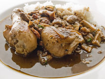 Coq au vin. Chicken legs in red wine sauce french style Royalty Free Stock Photography