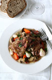 Coq au vin. French red wine chicken stew with mushroom and vegetables Stock Photos