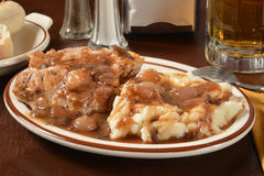Coq Au Vin. Boneless chicken breasts in a red wine sauce with mashed potatoes Royalty Free Stock Photo
