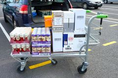 COQUELLES, PAS-DE-CALAIS, FRANCE, MAY 07 2016: Shopping trolley loaded with cheap beer and wine Stock Images