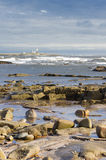 Coquet island. With surf breaking on rocks Royalty Free Stock Photos