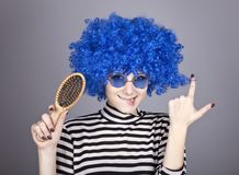 Coquette blue-hair girl with comb. Stock Image