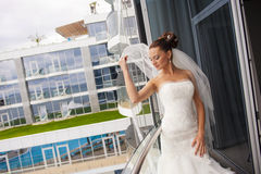 The coquette bride on the balcony. Royalty Free Stock Photos