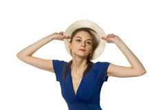 Coquette and cap. Young coquette fitting straw cap Stock Photos