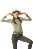 Coquette girl and bonnet. Coquette posing with straw hat Royalty Free Stock Images